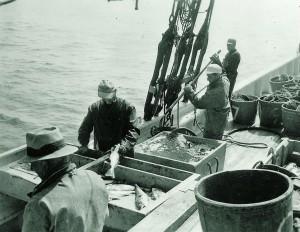 Fisherman work on the Adventure