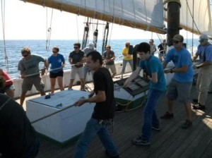 It takes a number of folks to get those big sails up